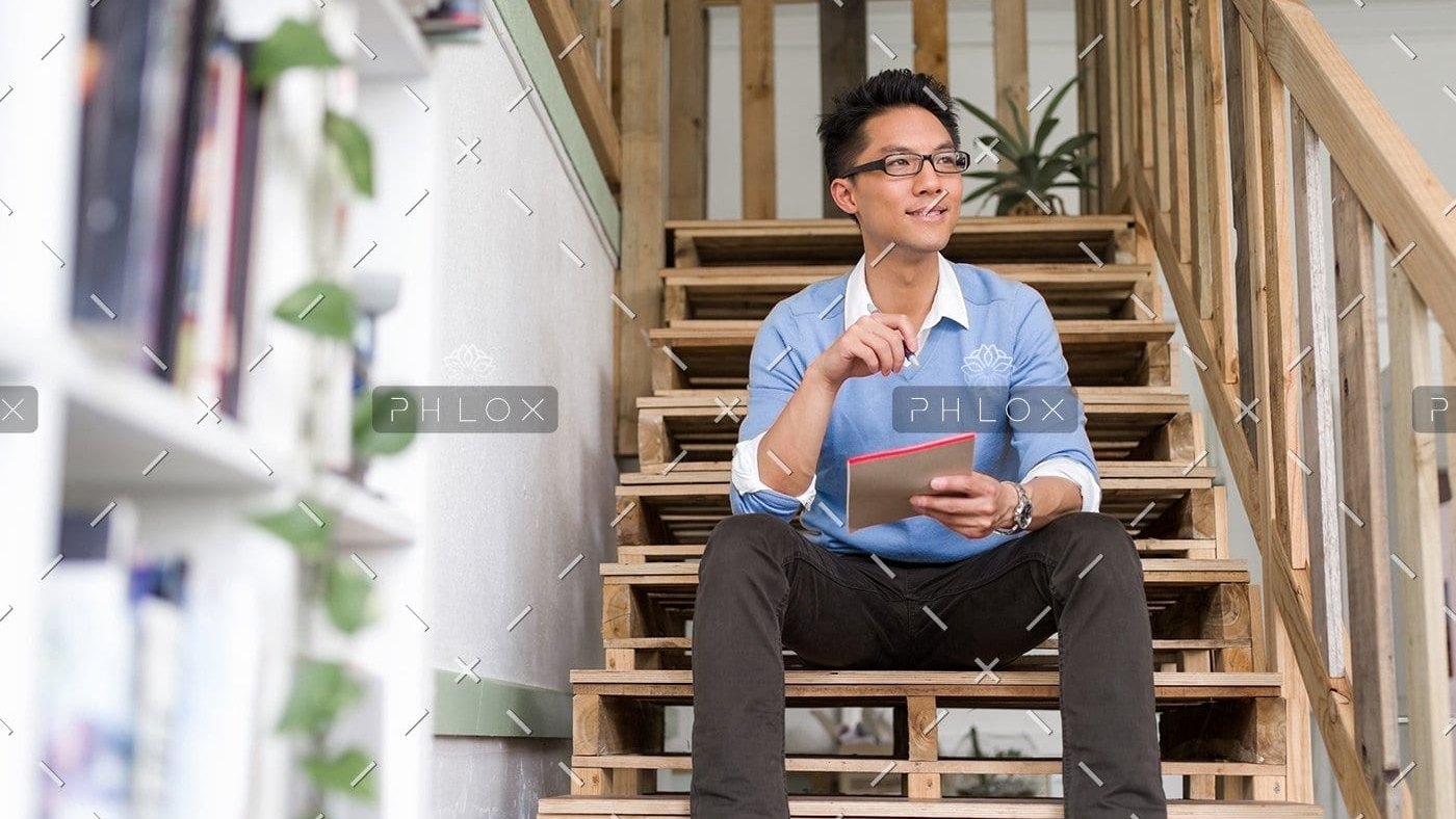 portrait-of-young-businessman-in-casual-P86QBSV