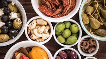Selection of tapas in ceramic bowls, overhead view