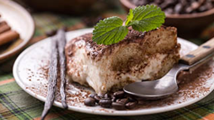 Tiramisu dessert served on white plate